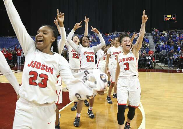 Judson's Chriresha King (23), Kyra White (22), Kierra Sanderlin (20) and Corina Carter (03) celebrate after their victory against Allen in the UIL Conference 6A girls basketball state semifinal at the Alamodome on Friday, March 1, 2019. The Rockets advance to the state final defeating the Eagles, 58-47. Photo: Kin Man Hui/San Antonio Express-News