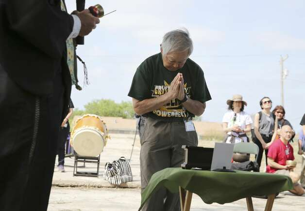 Joe Ozaki of Lakewood, Colorado bows in reverence during a memorial service near the former World War II internment camp in Crystal City on Saturday, Mar. 30, 2019. Ozaki was one of several internment survivors who attended a memorial in Crystal City and were interned there during World War II along with thousands of Japanese Americans and Japanese Peruvians. Photo: Kin Man Hui/Staff Photographer
