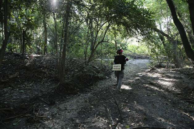 Anna Herr of Search & Support San Antonio searches deep in a thicket for Cecilia Huerta Gallegos on Saturday, July 27, 2019. Gallegos, 30, was last seen in the 5600 block of Southwick Street on July 8, according to the San Antonio Police Department. On Saturday, about a dozen searchers including Gallegos' sister Mireya Lopez of Houston went to six different locations in an effort to draw to a close the disappearance of the mother of four children. Photo: Kin Man Hui/Staff Photographer