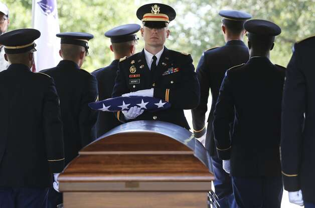Capt. Thomas Mooney, a casualty assistance officer, of U.S. Army South holds the folded flag that was draped over the coffin of Army Pvt. Penn Franks Jr. before presenting it to a member of Frank's family during a funeral service in Franks' honor at Fort Sam Houston National Cemetery on Friday, Aug. 16, 2019. Photo: Kin Man Hui/Staff Photographer