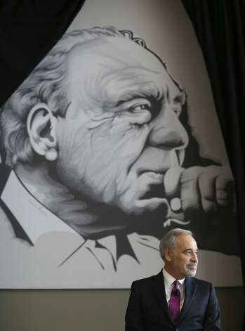 Former Congressional Representative Charlie Gonzalez sits under a mural of his father - one of San Antonio's most iconic politicians - Congressman Henry B. Gonzalez as family, friend and admirers gather at the Convention Center to see the unveiling of Gonzalez's resurrected mural on Wednesday, May 15, 2019. Photo: Kin Man Hui/Staff Photographer