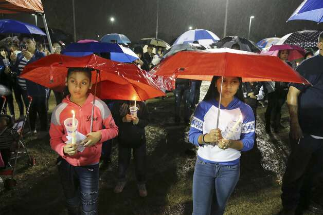 Mercedes Zamora (right) and her sister, Lexus, join others in the rain for a prayer vigil for King Jay Davila, the 8-month-old baby who has been missing for nearly a week, on Friday, Jan. 11, 2019 in Monterrey Park. On Thursday prior to tonight's vigil, law enforcement reported that the child's body was found. Photo: Kin Man Hui/San Antonio Express-News