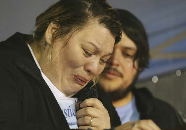 With her husband, Joshua, standing by her side Adriana Gomez, a cousin to King Jay Davila, fights back tears as she speaks at a prayer vigil for the 8-month-old baby who has been missing for nearly a week on Friday, Jan. 11, 2019 in Monterrey Park. Photo: Kin Man Hui/San Antonio Express-News