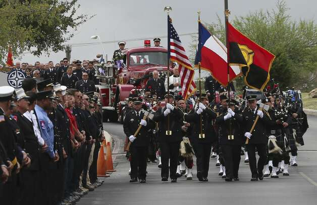 The San Antonio Fire Department Honor Guard leads a procession for the funeral service for firefighter Greg Garza at Community Bible Church on Thursday, Oct. 24, 2019. Firefighters from SAFD and surrounding areas including other first responders gathered at the church to honor Garza who died last week while on duty. Photo: Kin Man Hui/Staff Photographer