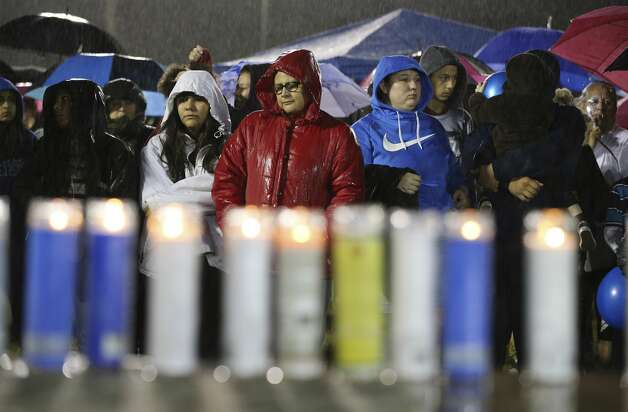People gather as rain falls during a prayer vigil for King Jay Davila, the 8-month-old baby who has been missing for nearly a week, on Friday, Jan. 11, 2019 in Monterrey Park. Photo: Kin Man Hui/San Antonio Express-News