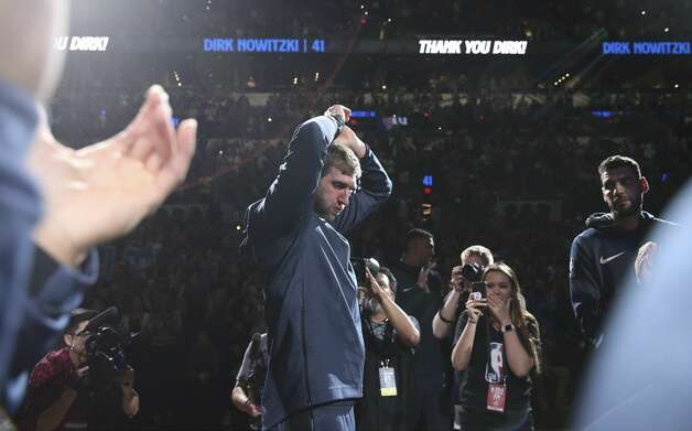 Dallas Mavericks' Dirk Nowitzki (41) appears emotional after a tribute video by the Spurs before the start of their game at the AT&T Center on Wednesday, Apr. 10, 2019. Photo: Kin Man Hui/Staff Photographer