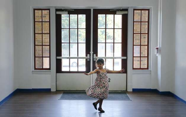 Catalina Aceves finds a space to do a little dancing as her family attend a first meet and greet with teachers as the city's first all-girls public elementary school at San Antonio ISD's Young Women's Leadership Academy Primary on Friday, Aug. 9, 2019. Photo: Kin Man Hui/Staff Photographer