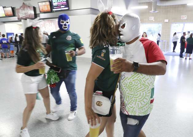 Soccer fans Francisco Garcia (from right), Olivia Michel, Juan Carlos Hernandez Flores and Veronica Michel dance along the corridors of the Alamodome as they attend the International Friendly soccer match between Mexico and Argentina on Tuesday, Sept. 10, 2019. Photo: Kin Man Hui/Staff Photographer