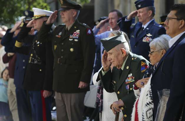 90-year-old Tomas Fajardo (third from right), U.S. Army veteran of World War II, Korean and Vietnam wars, salutes along with the commanders from their respective branches of the military during the retiring of colors at the U.S. Veterans Day Parade Association's wreath presentation ceremony at the Alamo on Saturday, Nov. 9, 2019. Photo: Kin Man Hui/Staff Photographer