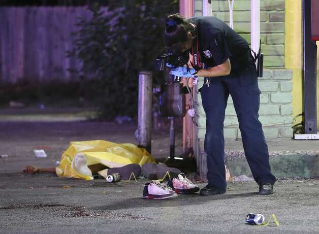 Police on scene of a triple shooting on the city's Eastside on Wednesday, Oct. 9, 2019. Police Chief William McManus said the shooting started due to an argument between three individuals. Two male victims were dead on the scene and a third transported to SAMC in critical condition with a gunshot wound to the face. Photo: Kin Man Hui/Staff Photographer