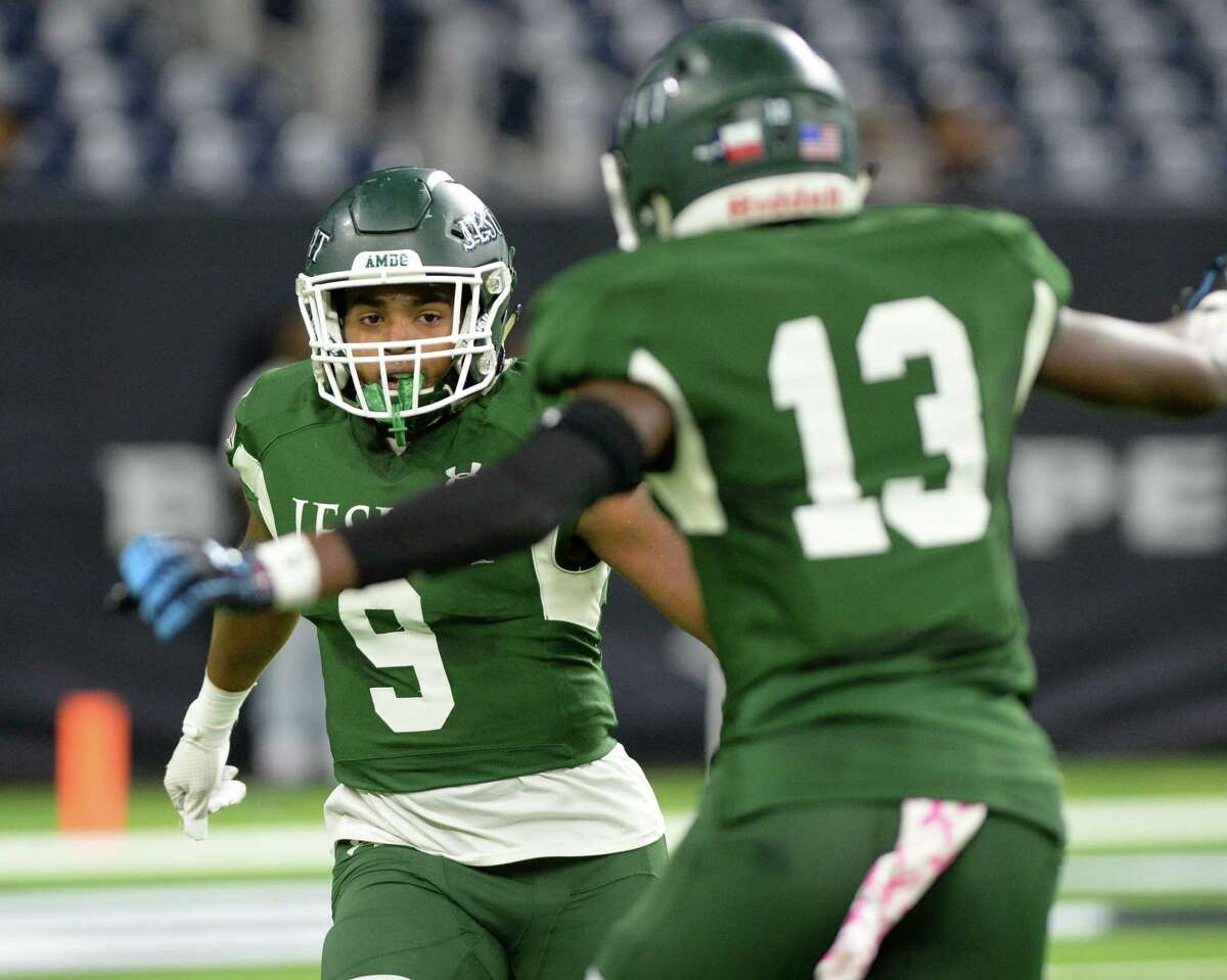 Dylan Campbell (9) and Robert Smith (13) of Strake Jesuit celebrate a touchdown during the first quarter of a Class 6A Division II Region III semifinal football playoff game between the Strake Jesuit Crusaders and the Cy Creek Cougars on Friday, November 29, 2019 at NRG Stadium, Houston, TX.