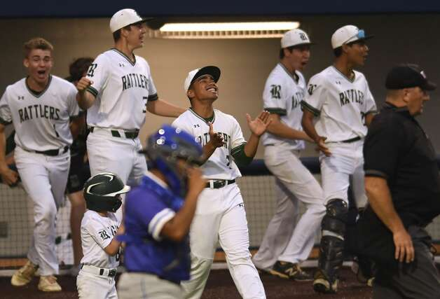 The Reagan bench reacts after teammate Cal Martin hit a grand slam homer against MacArthur High School during the 27-6A baseball action at the NEISD Sports Park on Tuesday, April 23, 2019. Photo: Billy Calzada/Staff Photographer