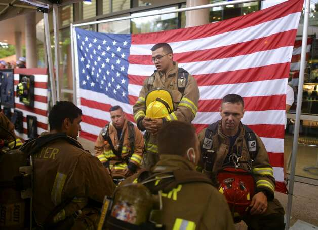 James Nededog and other firefighters form Porter, Texas, prepare for the San Antonio 110 9/11 Memorial Climb at the Tower of the Americas in Hemisfair Park on Wednesday, Sept. 11, 2019. The event marked the 18th anniversary of the terrorist attacks that killed 343 firefighters and many other first responders at the site of the World Trade Center, with many more perishing at the Pentagon in Washington, DC, and the crash of United Flight 93 in Pennsylvania. Photo: Billy Calzada/Staff Photographer
