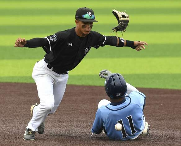 Clark second baseman Jeremy Anaya loses his glove as he attempts to tag Donovan Sanders of Johnson during Game 1 of their best-of-3 first round playoff series at North East Sports Park on Thursday, May 2, 2019. Photo: Billy Calzada/Staff Photographer