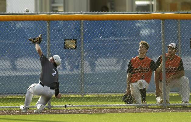 Boerne Champion shortstop Michael Gresham (7) makes a sliding catch of a foul pop fly during Game 2 of the best of three Class 5A baseball playoff series against Medina Valley on Friday, May 17, 2019. Photo: Billy Calzada/Staff Photographer
