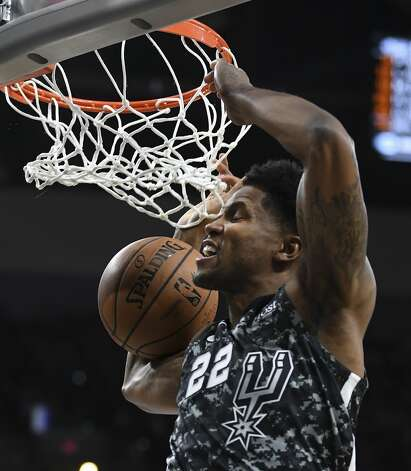 Rudy Gay of the San Antonio Spurs dunks against the Miami Heat during first-half NBA action in the AT&T Center on Wednesday, March 20, 2019. Photo: Billy Calzada/Staff Photographer