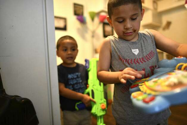 Brothers Leroy, 6, and Noah Gomez, 4, play in the apartment from which their family might be evicted on July 19, 2019. Over the last decade, evictions Ñ and the instability that follows them Ñ have become a much more prevalent threat for San AntonioÕs families. Photo: Billy Calzada/Staff Photographer