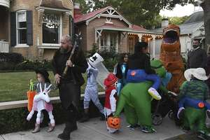 Trick-or-treaters crowd the sidewalk in the King William Historic District on Halloween night, Oct. 31, 2019. The neighborhood, located south of downtown, is one of the most popular trick-or-treating locations in San Antonio because the residents are generous and friendly.