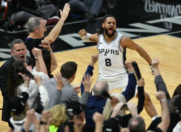 San Antonio Spurs guard Patty Mills reacts after hitting a three-point shot to put the Spurs ahead 114-110 with 13 seconds left in the game against the Cleveland Cavaliers in the AT&T Center on Thursday, March 28, 2019. Photo: Billy Calzada
