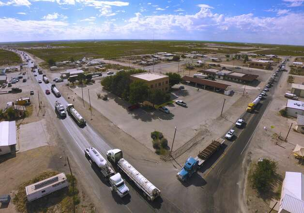 The oil boom has brought heavy truck traffic to Mentone, the only settlement in Loving County in West Texas. The county courthouse is at the center of this picture. Photo: Billy Calzada/Staff Photographer