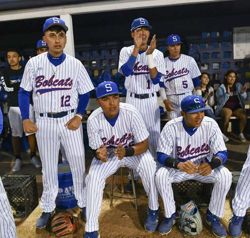 Juan Sandoval, seated middle, and brother Giovanni Sandoval (1) join teammates in watching action on the field during a South San baseball game on March 22, 2019. They are two of four quadruplets born to Juan and Maria Sandoval on Aug. 25, 2001 in San Antonio. Their sister, Julianna, is a trainer on the team and is seated at back right. Photo: Billy Calzada/Staff Photographer