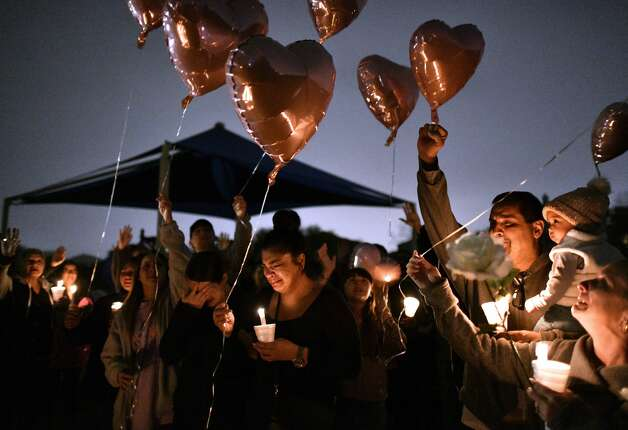 Sally De Leon, middle, older sister of Kaitlin Leonor Castilleja, 18, who was stabbed to death because of a social media feud, releases a balloon, along with other family members, during a vigil for her fallen sister on Friday night, March 1, 2019. A 16-year-old James Madison High School student has been arrested in the case. Photo: Billy Calzada/Staff Photographer