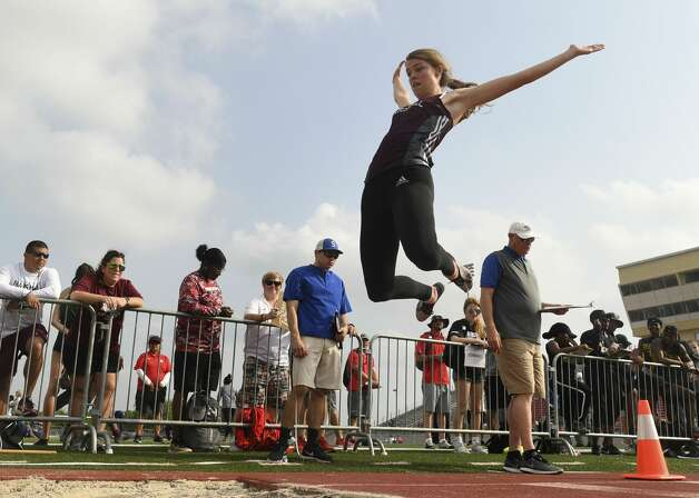 Rebecca Henderson of Marshall competes in the long jump during the UIL District 27/28-6A area track meet at Rutledge Stadium in Converse on Wednesday, April 17, 2019. Photo: Billy Calzada/Staff Photographer