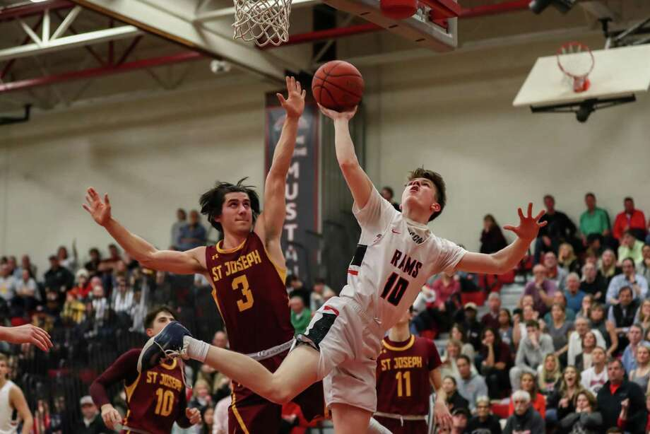 Ryan McAleer (10) of New Canaan just gets a shot up and in over Stephen Paolini (3) of St. Joseph during the Division IV Semi Final game between St. Joseph High School Boys Varsity Basketball and New Canaan Boys Varsity Basketball on March 12, 2019 at Warde - Fairfield High School in Fairfield, CT. Photo: John McCreary / For Hearst Connecticut Media / Connecticut Post Freelance