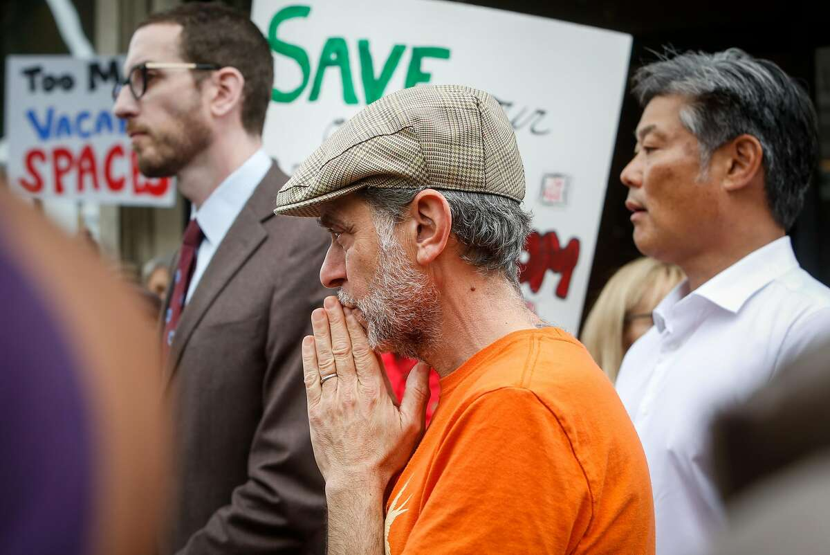 Owner of Caffe Sapore, Elias Bikahi, listens as elected officials speak at a demonstration gathering in support of saving his long-time neighborhood cafe in North Beach San Francisco, Calif. on Thursday, Nov. 14, 2019.