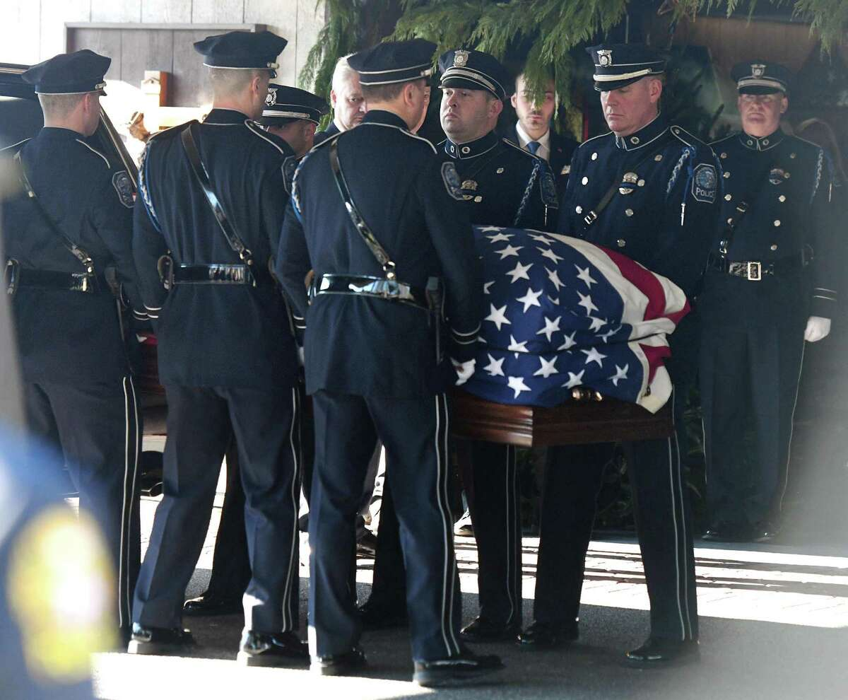 Greenwich Police Officers carry the casket of fellow Officer Justin Quagliani during his funeral service at St. Michael the Archangel Church in Greenwich, Conn. Monday, Dec. 23, 2019. Officer Quagliani, a native of West Haven, died of a heart attack at age 38 on Dec. 17.