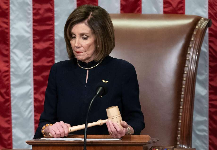 House Speaker Nancy Pelosi presides over the impeachment of President Trump this month. Photo: Saul Loeb / AFP / Getty Images