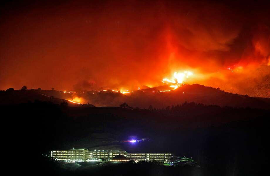 The River Rock Casino sits below a ridge line on fire as the Kincade Fire burns outside Geyserville, Calif., on Thursday, October 24, 2019. Photo: Carlos Avila Gonzalez / The Chronicle 2019