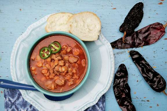 Posole rojo is made with hominy, cubed pork and a sauce made from dried red chile.