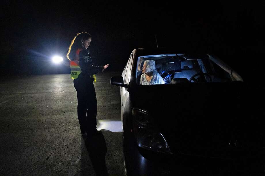 Motorist Claire Miller waits for evacuation orders to be lifted during power shut-offs amid an October fire in Moraga. Photo: Nick Otto / Special To The Chronicle