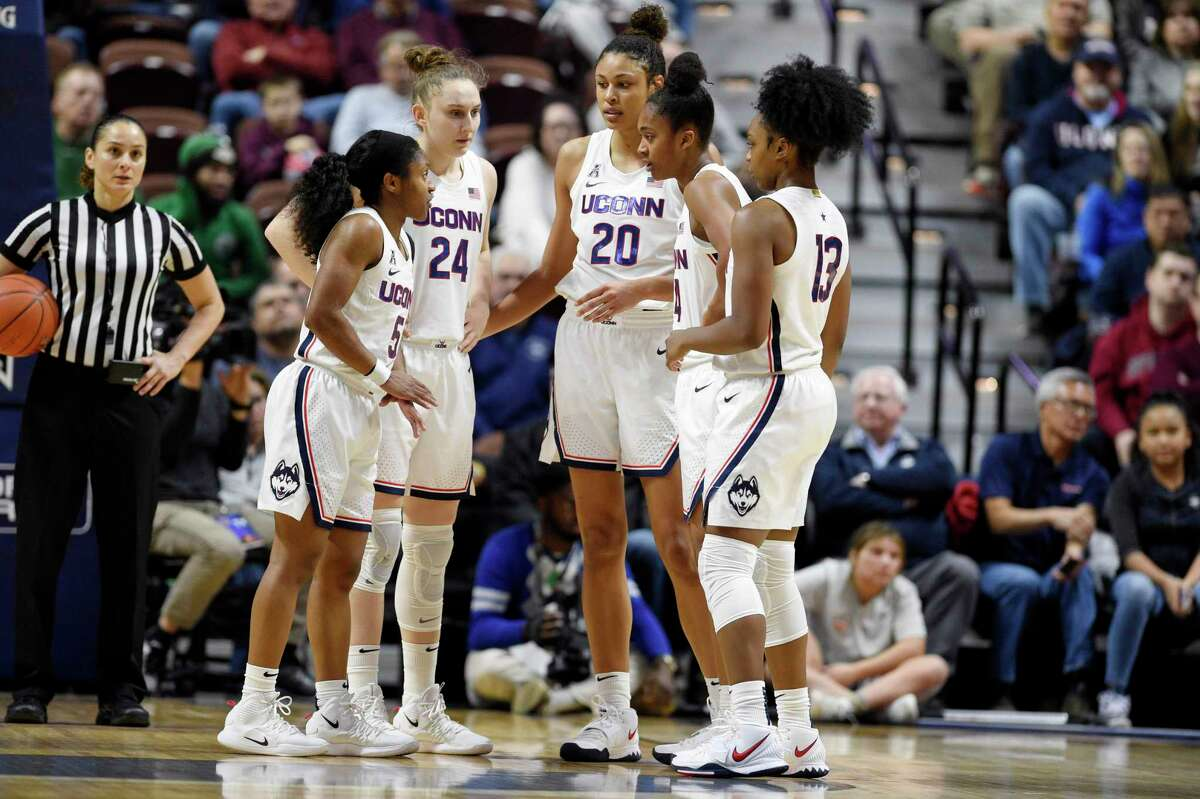 Connecticut's Crystal Dangerfield (5), Connecticut's Anna Makurat (24), Connecticut's Olivia Nelson-Ododa (20), Connecticut's Aubrey Griffin (44), and Connecticut's Christyn Williams (13) in the second half of an NCAA college basketball game, Sunday, Dec. 22, 2019, in Uncasville, Conn. (AP Photo/Jessica Hill)