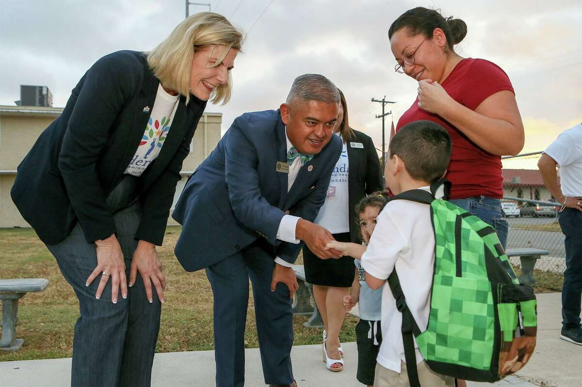In happier days in 2019, Edgewood ISD Superintendent Eduardo Hernández greets a student. The pandemic has magnified education and poverty gaps, so the question is how do we make it right for students in coming years?
