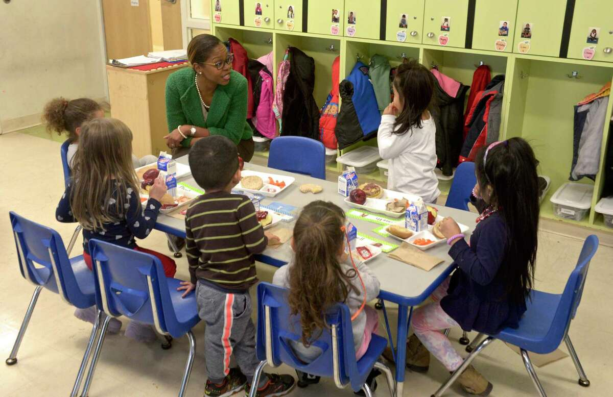 Nichole Taxiltsridis, the new director of early learning programs at the Connecticut Institute For Communities, talks with students enjoying lunch at Head Start in Danbury, Conn. Thursday, December 19, 2019.