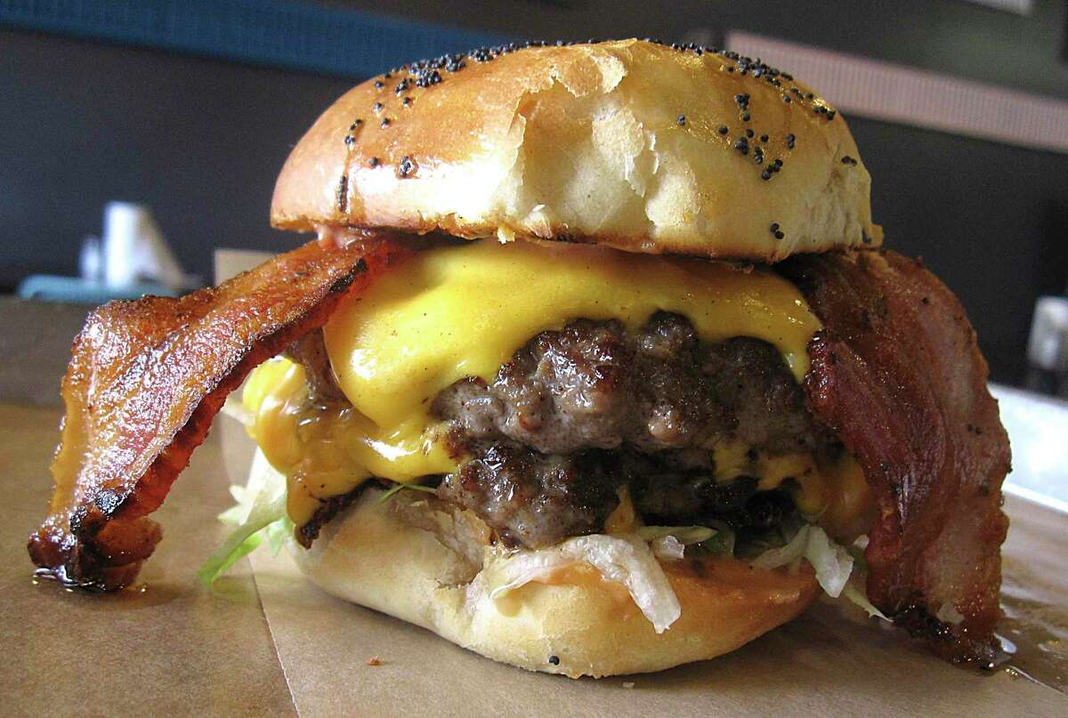 """Respected local chef Andrew Weissman will be able to continue operating his burger business under the """"Mr. Juicy"""" name, despite attempts from the owners of Longhorn Cafe, another San Antonio restaurant, to stop it."""