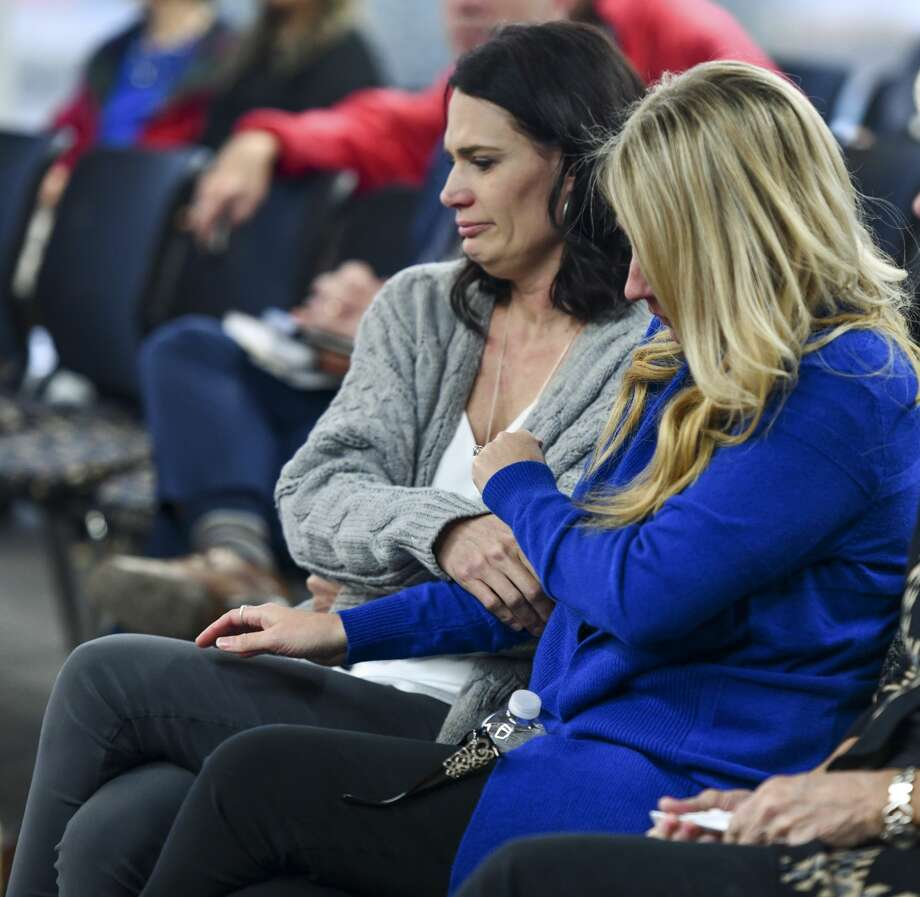 Marcy Askins, left, and Carla Byrne, sisters of shooting victim Joe Griffith, comfort each other after testifying at the Texas House Committee on Mass Violence Prevention and Community Safety Nov. 7 at the Zant Community Room at Odessa College. Photo: Jacy Lewis/Reporter-Telegram
