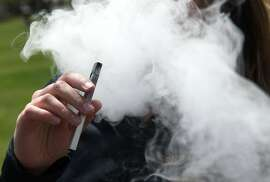 A teen from a Juul e-cigarette  in Oakland, Calif. Wednesday, May 16, 2018.