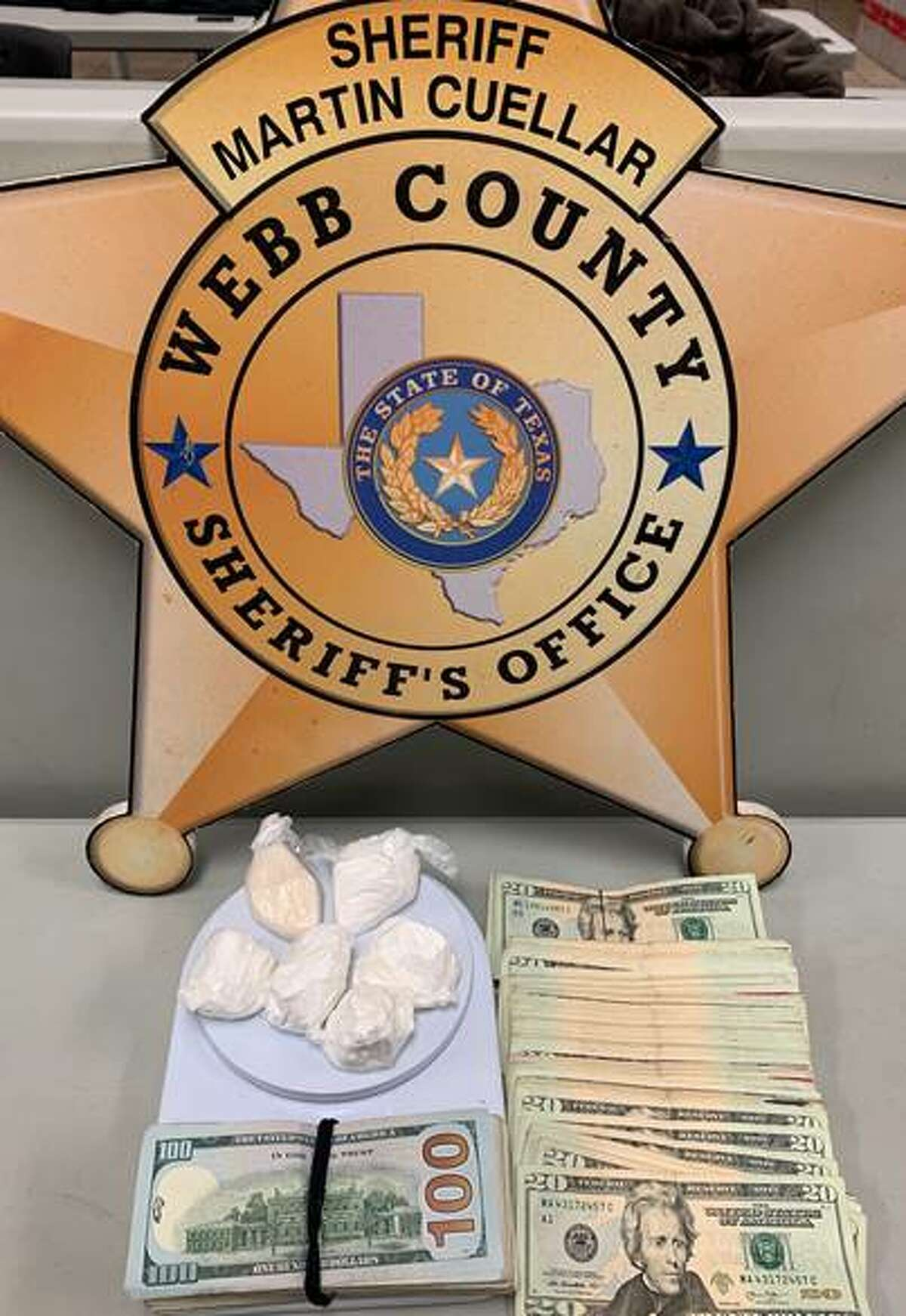 Shown are the 5.4 ounces of cocaine and $2,474 seized Friday from a residence in the 1300 block of Rosario Street.