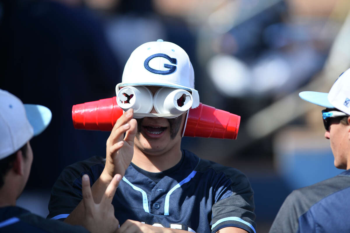 Greenwood High School's Nick Urias wears a mask made from cups and athletic tape in the dugout during a West Texas March Classic game against Alpine on March 9 at Security Bank Ballpark.