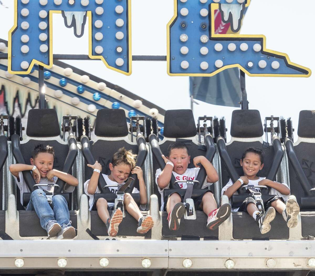Youth take a ride on Aug. 24 at the Midland County Fair at the Horseshoe.