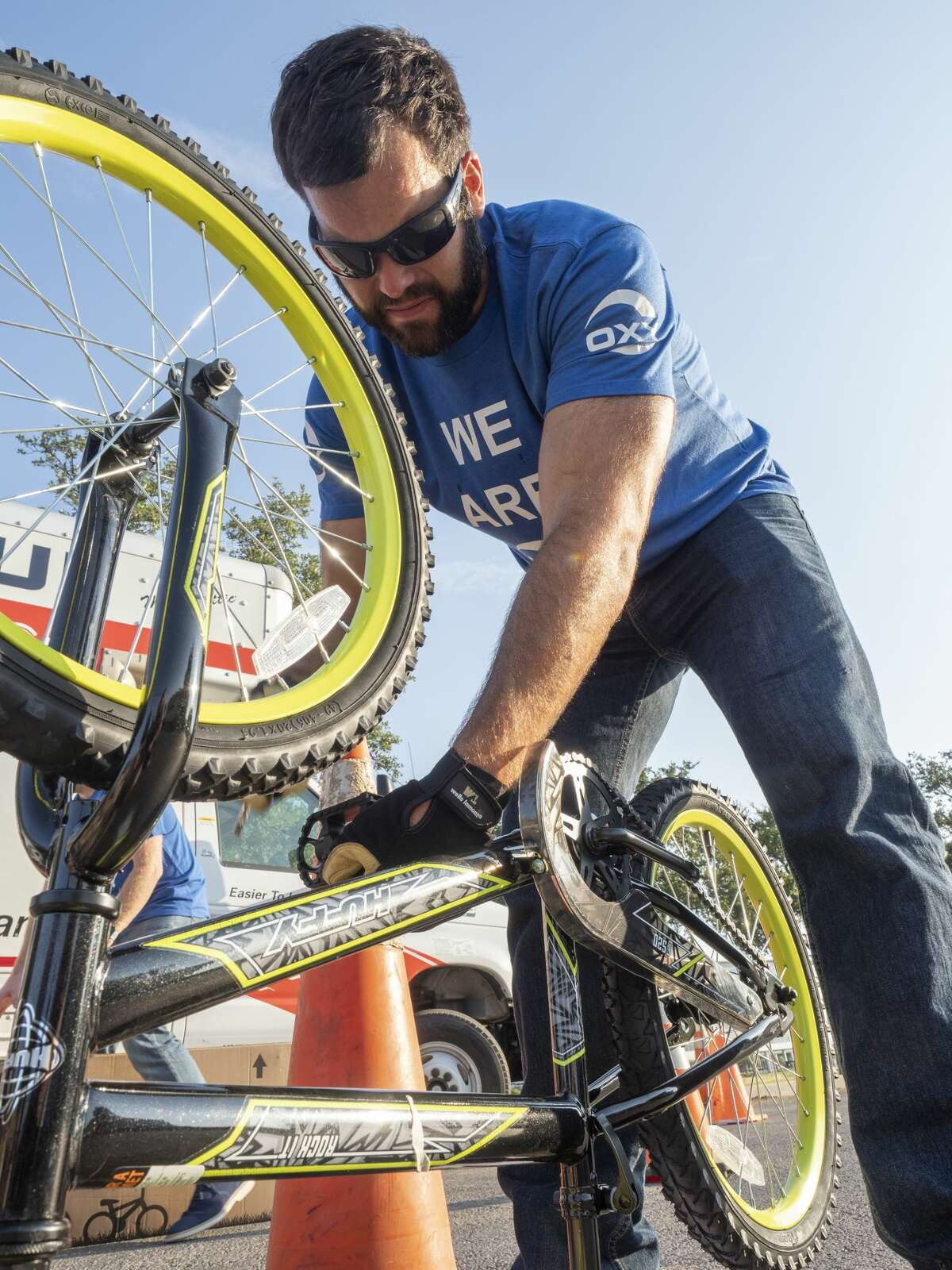 Jason Zapalac and other Occidental Petroleum employees partner with Wish for Wheels on Aug. 29 to build bikes for area youth.