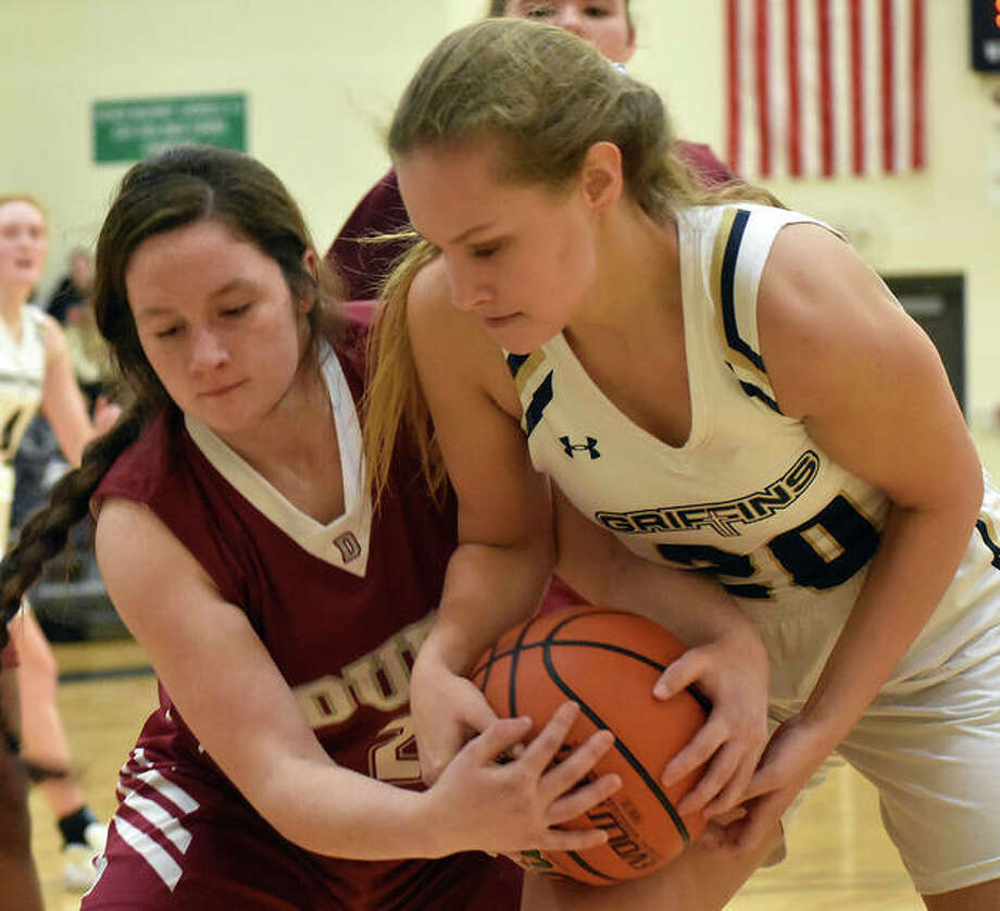 FMCHS sophomore forward Libby Telthorst, right, fights for the ball with a Dupo player during a game in the regular season. Photo: Matt Kamp|The Intelligencer