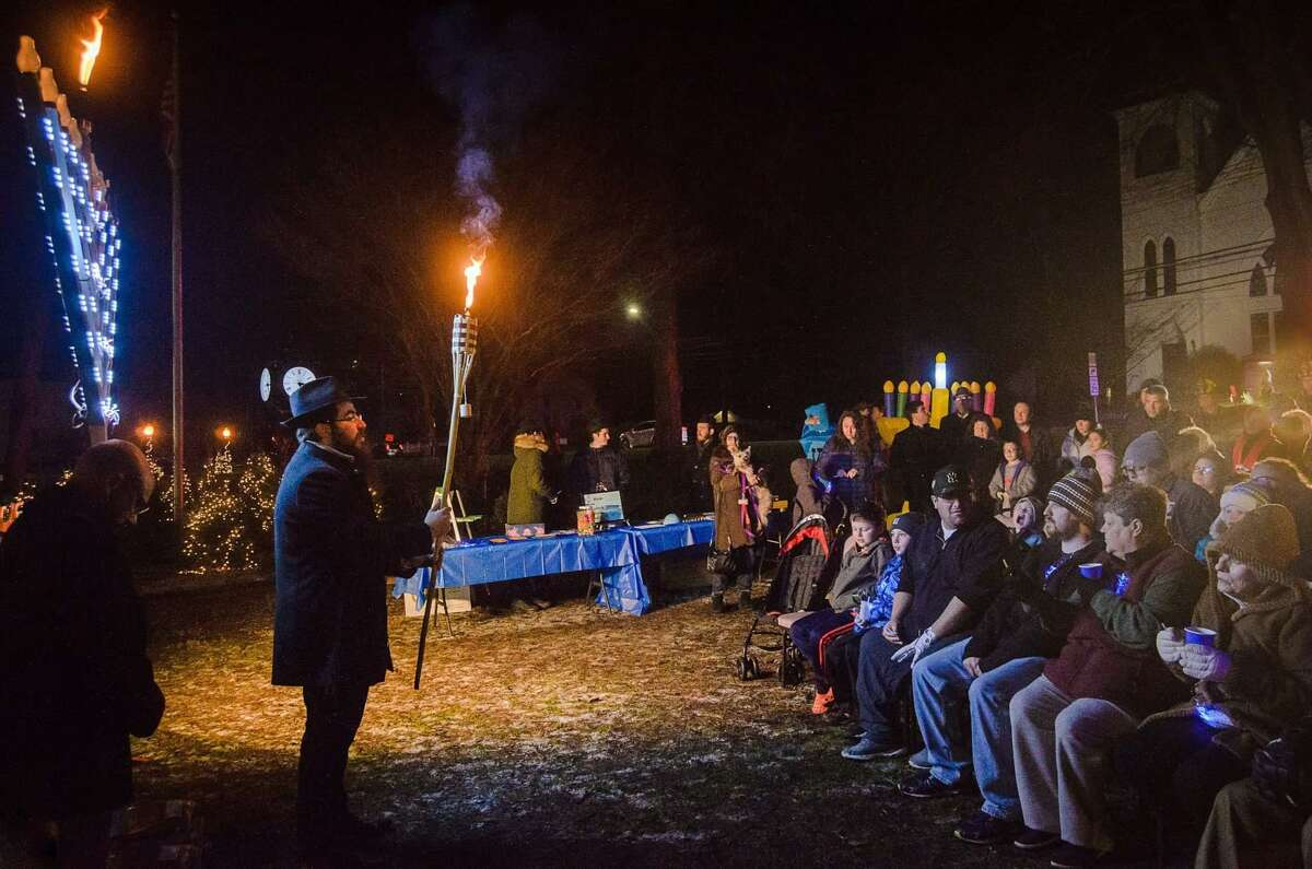 Chabad of Shelton & Monroe, led by Rabbi Shneur Brook, hosted a gathering for the annual menorah lighting celebration on the Huntington Green on Sunday.