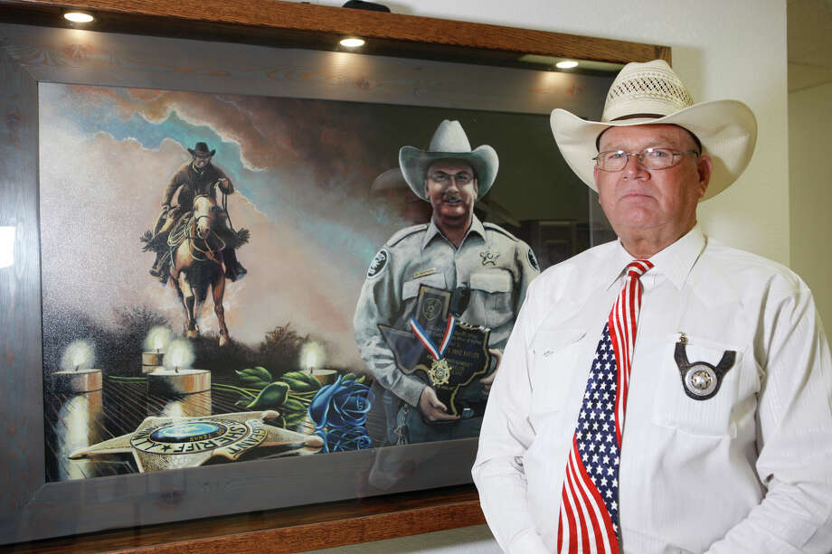 Midland County Sheriff Gary Painter was photographed for USA Today standing with a portrait of Sgt. Mike Naylor in the William Ahders Justice Center that houses the sheriff's office. Naylor was killed Oct. 9, 2015, while serving a warrant in Midland County. Photo: James Durbin/James Durbin For USA Today / James Durbin