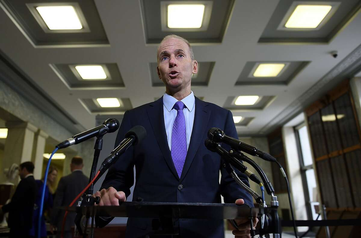 In this file photo taken on Oct. 30, 2019, then-Boeing CEO Dennis Muilenburg makes a statement to the media before testifying at a hearing in front of a congressional lawmakers on Capitol Hill in Washington, D.C.