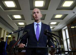 "(FILES) In this file photo taken on October 30, 2019 Boeing CEO Dennis Muilenburg makes a statement to the media before testifying at a hearing in front of a congressional lawmakers on Capitol Hill in Washington, DC on. - Boeing on December 23, 2019 replaced its embattled chief executive, Dennis Muilenburg, saying a change was needed as it attempts to restore its reputation amid the protracted 737 MAX crisis. Boeing named Chairman David Calhoun as its chief executive, saying the company needed to ""restore confidence"" and ""repair relationships with regulators, customers and all other stakeholders."" (Photo by Olivier Douliery / AFP) (Photo by OLIVIER DOULIERY/AFP via Getty Images)"