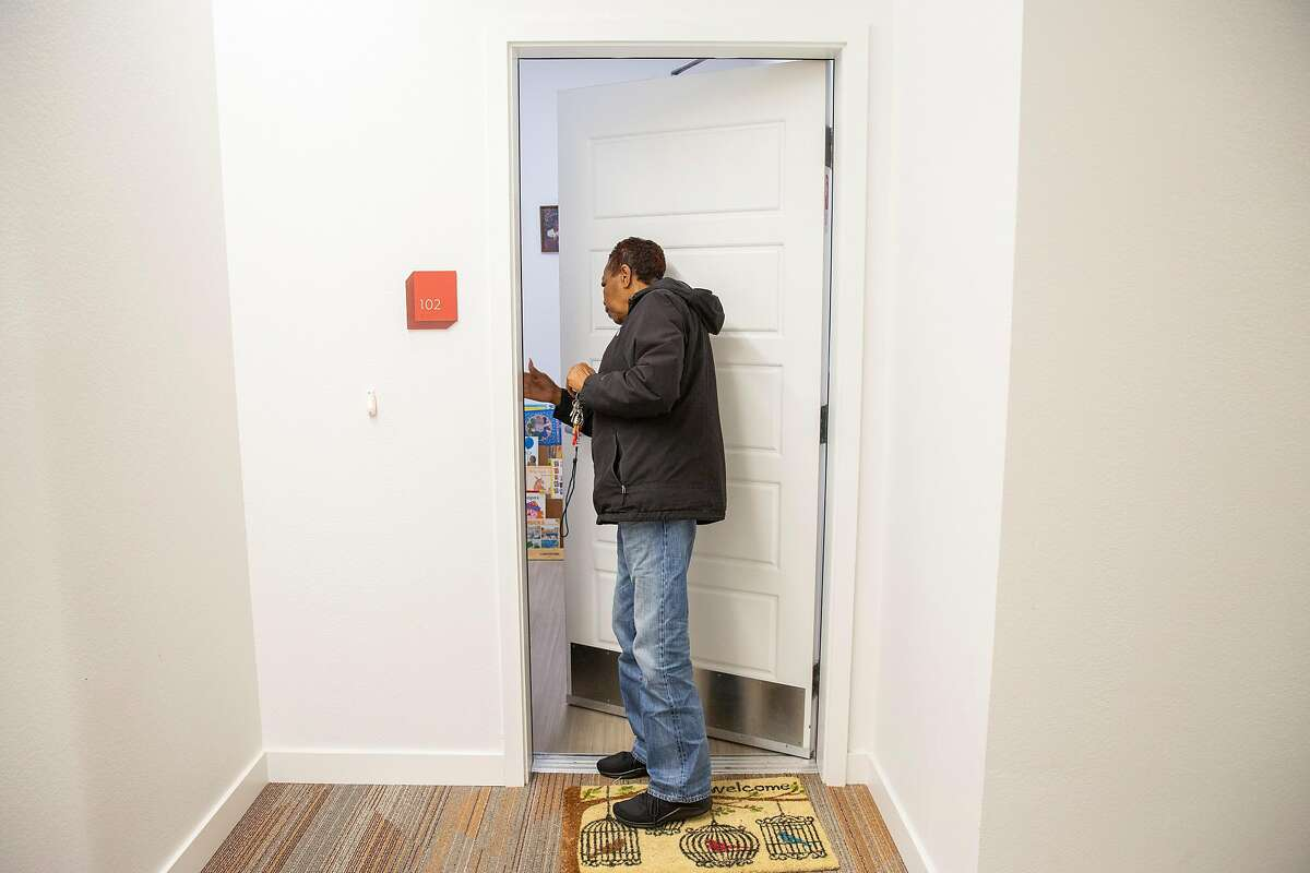 Leola Brown, 69, closes her apartment door at BRIDGE Housing on Thursday, Dec. 19, 2019, in San Francisco, Calif. Brown lived across the street at 26th and Wisconsin streets for more than four decades before moving into BRIDGE Housing. The block of her former home is being demolished and developed with hundreds of apartments, as part of the Potrero HOPE SF project.